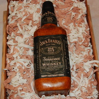 "Jack Daniels Cake Bottle is gumpaste. The ""box"" is 13 X 9 carrot cake with cream cheese buttercream. ""Straw "" is fondant strips. Thanks..."
