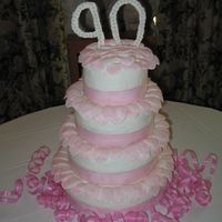 Tiered B-Day Cake I made this for my grandmother's 90th birthday... it was the first tiered cake I ever made! Frosting is buttercream, rose petals are...
