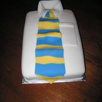 White Collar Father's Day Cake Made this for an early Father's Day cake... used fondant. It was a lot of fun!