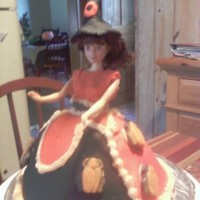 Halloween Witch Orange cake with orange b/c icing, dress is fondant, with b/c trim and gummy bugs. hat is fondant with O in honor of niece Olivia. Cake is...