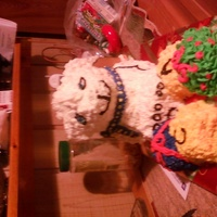 Christmas Bear I made this for 2 of my nephews for christmas dinner. Pan is Build a Bear cake pan, and the gifts around it are just big cupcakes. All...