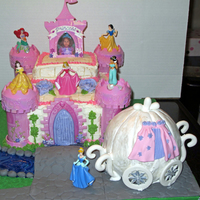 Disney Princess Cake Disney princess castle cake with princess carriage, cobblestone path and bridge, and moat.