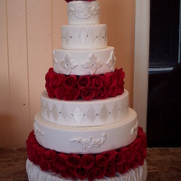 Wedding Cake 6 tier wedding cake..bottom teir is draped lace on others and have diamond crystals in or on lace, hope you like!!!