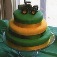 John Deer My very first cake, and LOVED it. This was made for a friends baby shower - whose theme is John Deer. All marshmallow fondant.