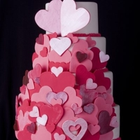Hearts Abound Here is a valentines cake that I did for a local charity. The hearts are made from gumpaste, and a select few have been painted with luster...