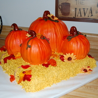 Fall Theme Wedding 100% edible...pumpkins & hay are buttercream, everything else is Caramel Creme MMF. The pumpkins are pumpkin spice cake & the...