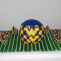 Wvu Birthday   Chocolate fudge cake covered with buttercream. Field is buttercream. Mini chocolate cupcakes w/ homemade Oreo football truffles.