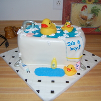 Rubber Duck Baby Shower All edible, except for the ducks. Half chocolate fudge cake w/ homemade chocolate whipped cream filling. Other half is french vanilla cake...