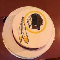 "Redskins Cake 2 tiers 8"" and 10"" yellow cake, buttercream frosting, fondant ribbon, fondant footballs, edible image"