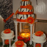 Quinceanera Cake 3 tier zebra print cake covered w/fondant 3 additional cakes are iced w/buttercream.