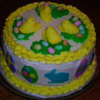 Easter Peeps Cake  I made this cake for the church Easter egg hunt. It's a 4 layer 10 inch round yellow cake with lemon mousse filling, buttercream,...