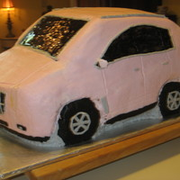 Pink Cadillac Srx   This was my first attempt EVER at a 3-D cake. It gave me a lot of trouble, but the client was very pleased w/ it. I learned a lot also!