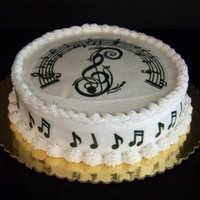 Music Note Cake Red Velvet cake with cream cheese filling, butter cream frosting. Decorations done on rice paper with edible markers. TFL