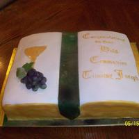 Communion Cake This is a 2 layer WASC cake with italian buttercream covered in fondant with fondant chalice and marzipan grapes. It was my first ime...