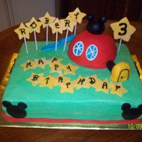 Mickey Clubhouse Cake This was for a friend's little boy. Cake is chocolate with bavarian cream filling, bc. Clubhouse is poundcake covered in fondant....