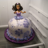 "Barbie made with a real barbie doll and 4-8"" round cakes covered in bc then airbrushed"