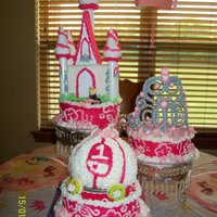 My Daughter's First Birthday Cake This is the photo of my daughter's first birthday cake. The top tier has the castle with the little princess made of fondant. I made...