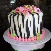 Zebra Stripe Birthday Cake Per my daughter's request for her 12th birthday. Zebra striped cake with pink and green accents.
