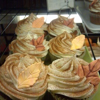 Autumn Cupcakes   Pumpkin spice cupcakes topped with cream cheese frosting and a variety of handmade gumpaste leaves.