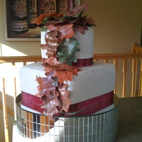 Fall Leaves  Bridal shower cake...fall themed. I made the leaves out of gumpaste (my first time using gumpaste) and them covered them with shimmer dust...