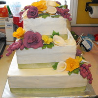 Roses And Grapevines all buttercream with gumpaste roses and grapes. TFL! :)