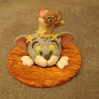 Tom And Jerry This was a madeira cake - Tom and the hammer are fondant covered cake, and Jerry is completely made of Fondant. The board is covered in...