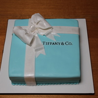 Tiffany & Co Birthday Cake This is now my 7th cake but I was a bit disappointed in the Fondant work. I used four 14x14cm cakes together to get the size which was my...