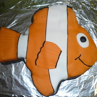 Nemo/fish Cake Nemo/fish cake......triple chocolate cake with sticky chocolate frosting (recipes listed on this site) iced in fondant with royal icing.