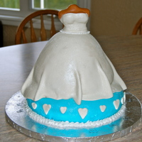 Bridal Shower Cake Bottom layer chocolate cake with chocolate mouse fillingDress vanilla bean cake with raspberry and white mouse.blue and white fondantAll...