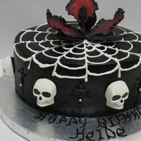 Goth Cake Strawberry cake flavor with fresh Strawberries & Glaze and Strawberry bc. The spider web and Skulls are made with chocolate. The flower...