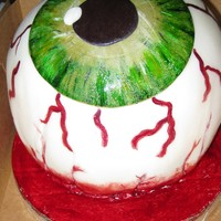 Severed Eyeball Very proud of my first eyeball cake. The cake had colored layers with a strawberry filling covered with a vanilla fondant.