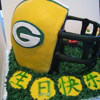 Green Bay Packers Helmet The Green Bay helmet was made with yellow cake, Bavarian cream filling and covered with Chocolate buttercream. All of the Sushi, chop...