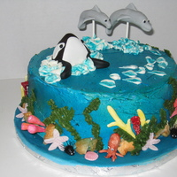 Whale & Dolphins Red Velvet cake with cream cheese filling and icing. The ocean details were made with gumpaste and choco-pan.