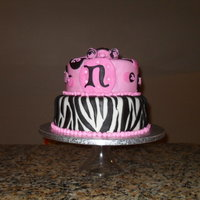 Pink And Black  black and pink zebra cake, pink and black are my fav colors there are sugar dimonds around the mongram. It was fun to do the zebra pattern...
