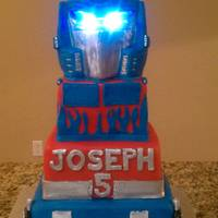 Transformer Cake With Led Lights For Eyes  This cake was alot of fun, I was so happy with end result and loved it even more when i put the lights in the eyes.worth the time i put in...