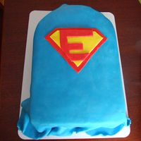 "Superman Cape Superman logo with an ""E"" for the birthday boy."