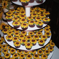 Sunflowers And More Sunflowers. 300 sunflower cupcakes for a wedding. Whew!