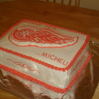 Detroit Red Wings Birthday Cake Chcolate cake with hazelnut chocolate filling, covered with crusting buttercream. The Red Wing logo was created using the Frozen...