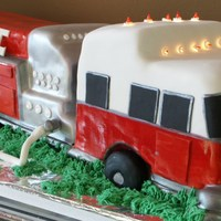 Fire Truck To The Resue Hand sculpted pound cake with rolled fondant and buttercream, hand painted with edible colors. Conner's 4th birthday.