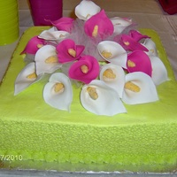 Square Cake With Calla Lillies Cake icing is buttercream. The Calla Lillies are fondant.
