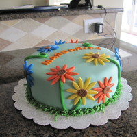 Daisies For Margarita MMF with MMF decorations. This cake was made for my mother in law's birthday; her name is Margarita (Spanish for Daisy).The design of...