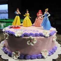 Princesses Everything buttercream but the princesses which are toys and the flowers that are made of RI.