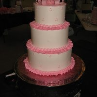 Pink Ribbon buttercream 3 tier cake with pink details and sugar paste bow