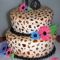 "Leopard Print And Daisies 6"" and 8"" rounds covered in white fondant. hand painted leopard print. GP daisies, leaves and '18' topper."