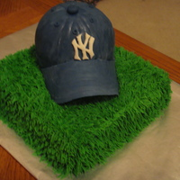 Yankees Baseball Cap I made this as my brother's Grooms cake. This was my first time making a baseball cap. It wasn't as hard as i thought it would be...