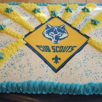 Cub Scouts Blue & Gold This cake was for my sons Cub Scout Blue & Gold banquet. It's an edible image on top and candy melt stars.