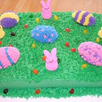 Marbled Cake W/buttercream Frosting, Jelly Beans & Peeps This cake was made for the staff at my son's school. Marbled cake with buttercream frosting. The eggs are chocolate cake. Peeps &...
