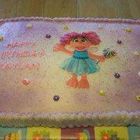 Abby Kadabra This is a new character from Sesame Street. She is made from an edible image. Royal icing flowers.