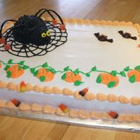 Halloween Cake With Spider Spider is mini ball with a marshmallow for the head. Frosted in Buttercream. Bats are candymelts and candy around the border. Made for...