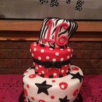 Kate's Sweet Sixteen Topsy Turvy  Our first topsy turvy cake made for a sweet sixteen. Had alot of fun making it. Bottom is 12' Chocolate with chocolate mousse filling...